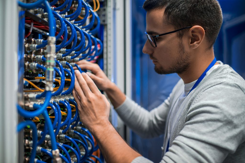 Service technician at cabling panel