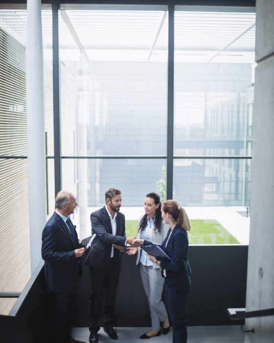 businesspeople-having-discussion-office (1)